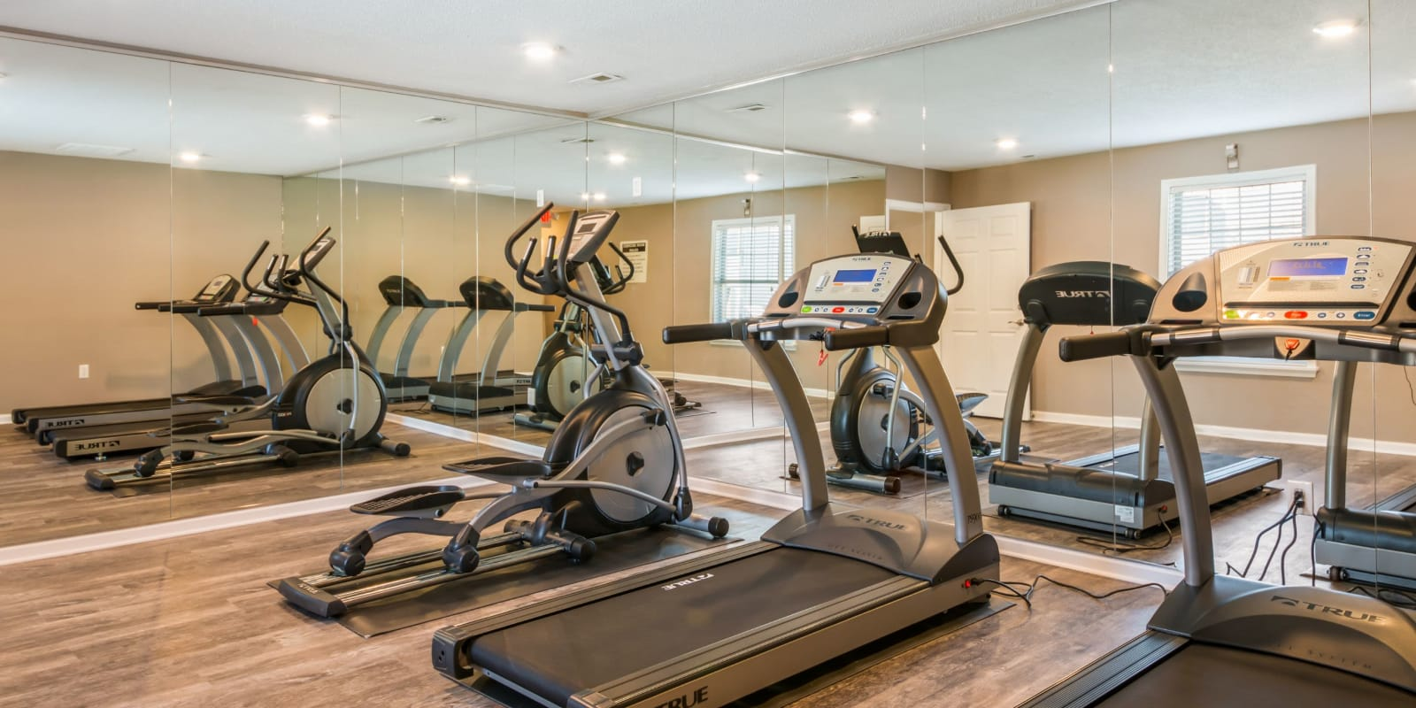 Fitness center with plenty of individual workout stations at Alexander Station Apartment Homes in Salisbury, North Carolina