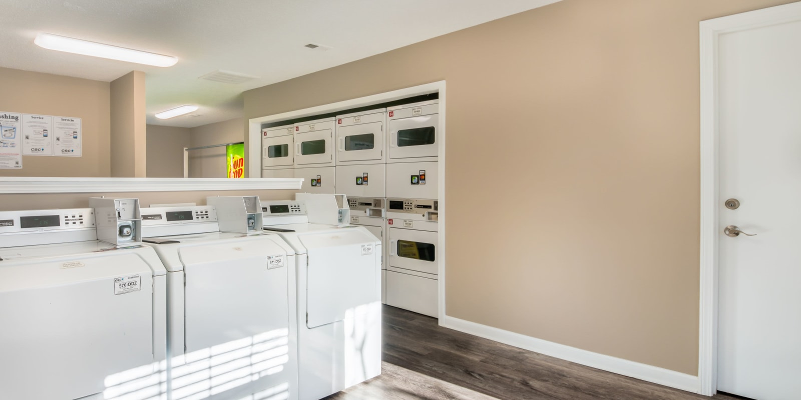 A community laundry room  with plenty of machines at Alexander Station Apartment Homes in Salisbury, North Carolina