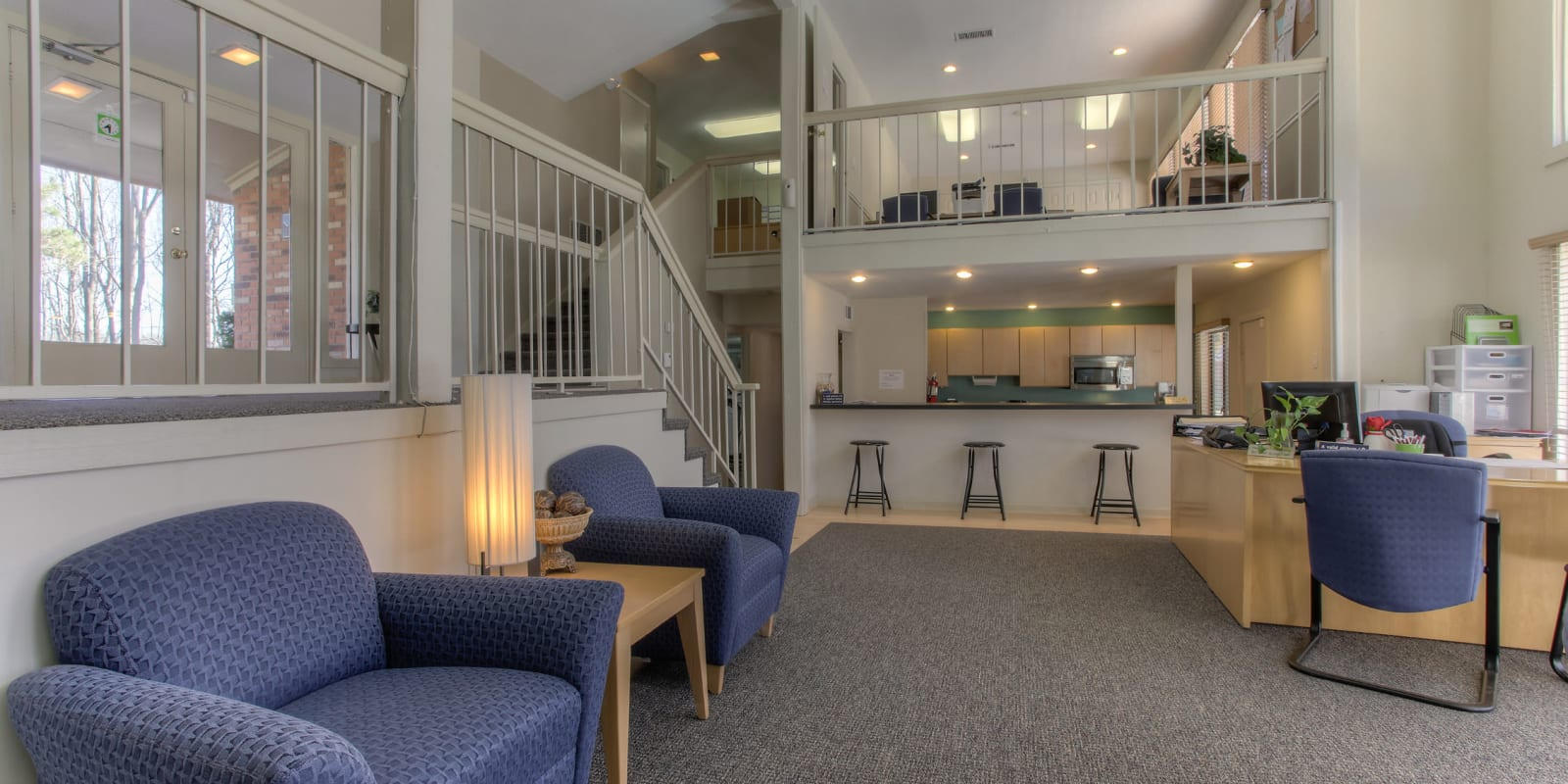 A two-story clubhouse with a resident kitchen at Enclave at North Point Apartment Homes in Winston Salem, North Carolina