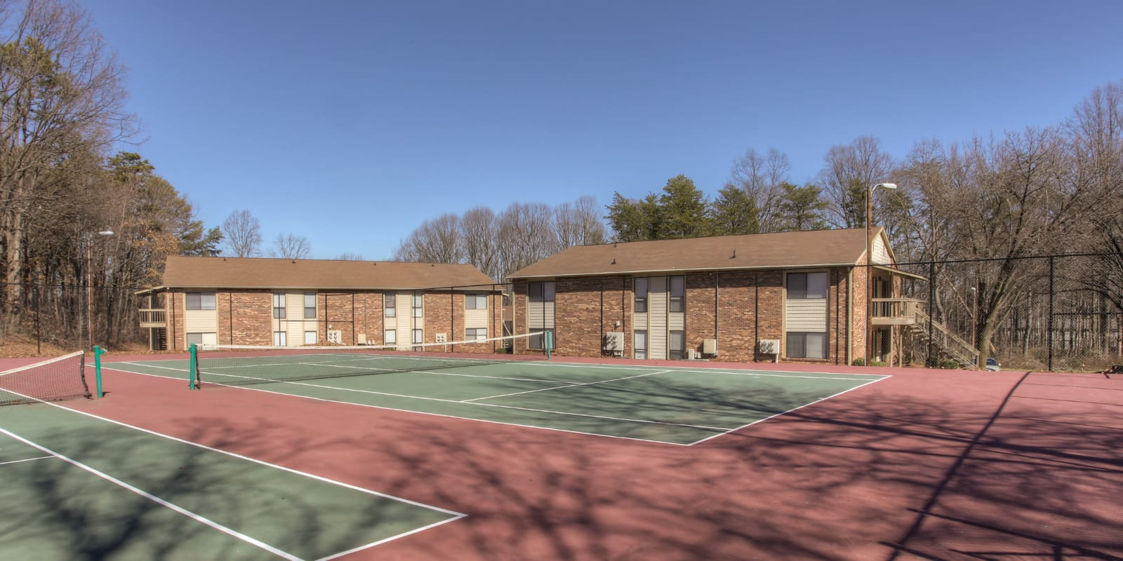 Two outdoor tennis courts at Enclave at North Point Apartment Homes in Winston Salem, North Carolina