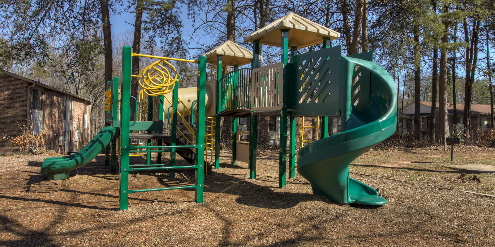 A children's playground with a slide at Enclave at North Point Apartment Homes in Winston Salem, North Carolina