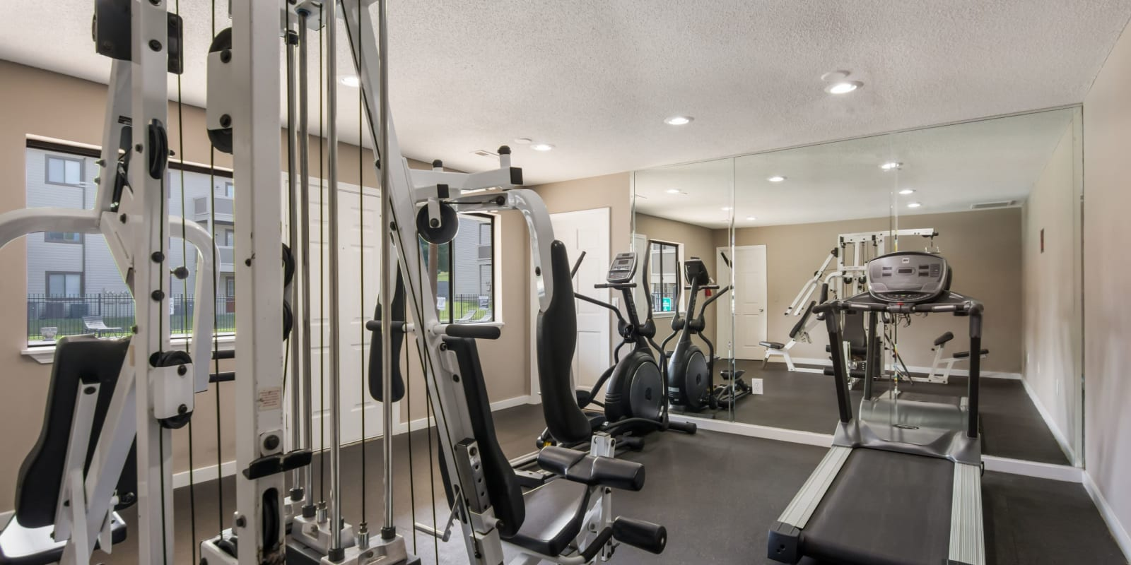 Fitness center with a treadmill at Gable Oaks Apartment Homes in Rock Hill, South Carolina