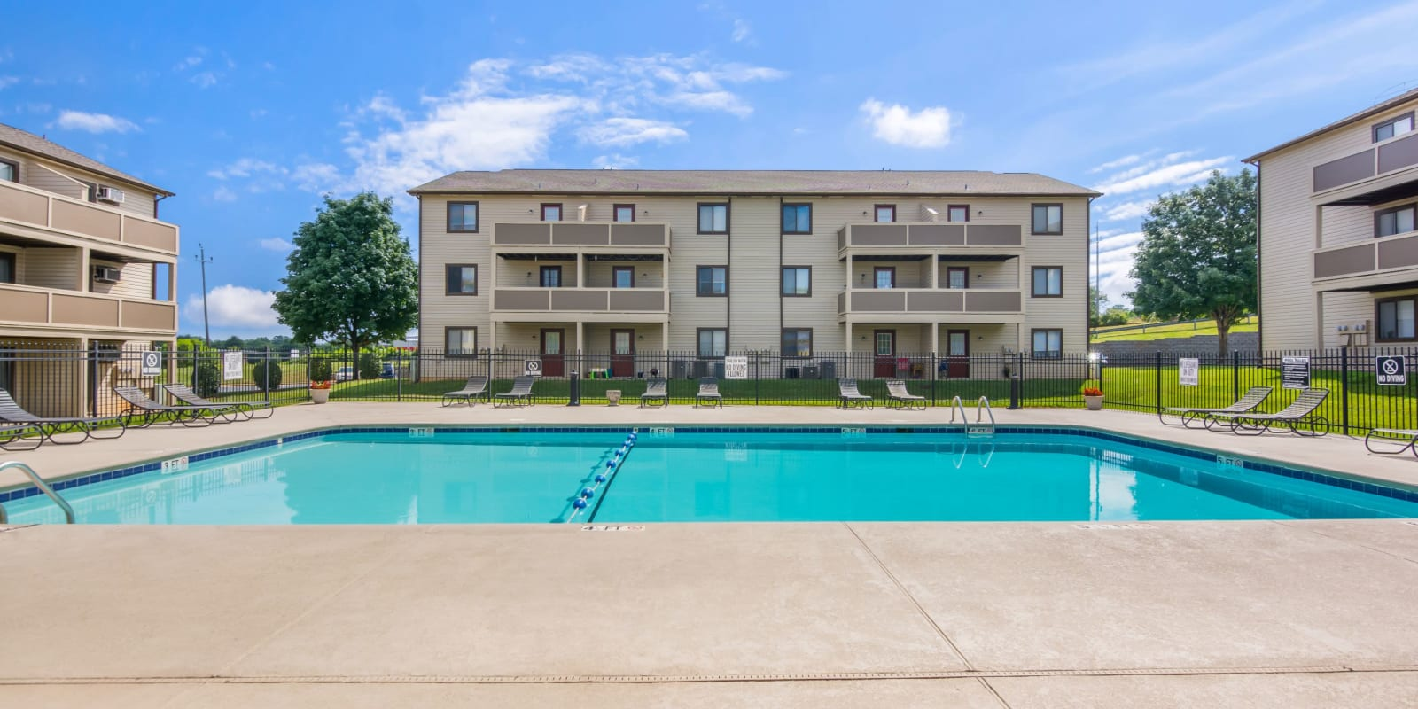 Large swimming pool with an expensive sundeck at Gable Oaks Apartment Homes in Rock Hill, South Carolina