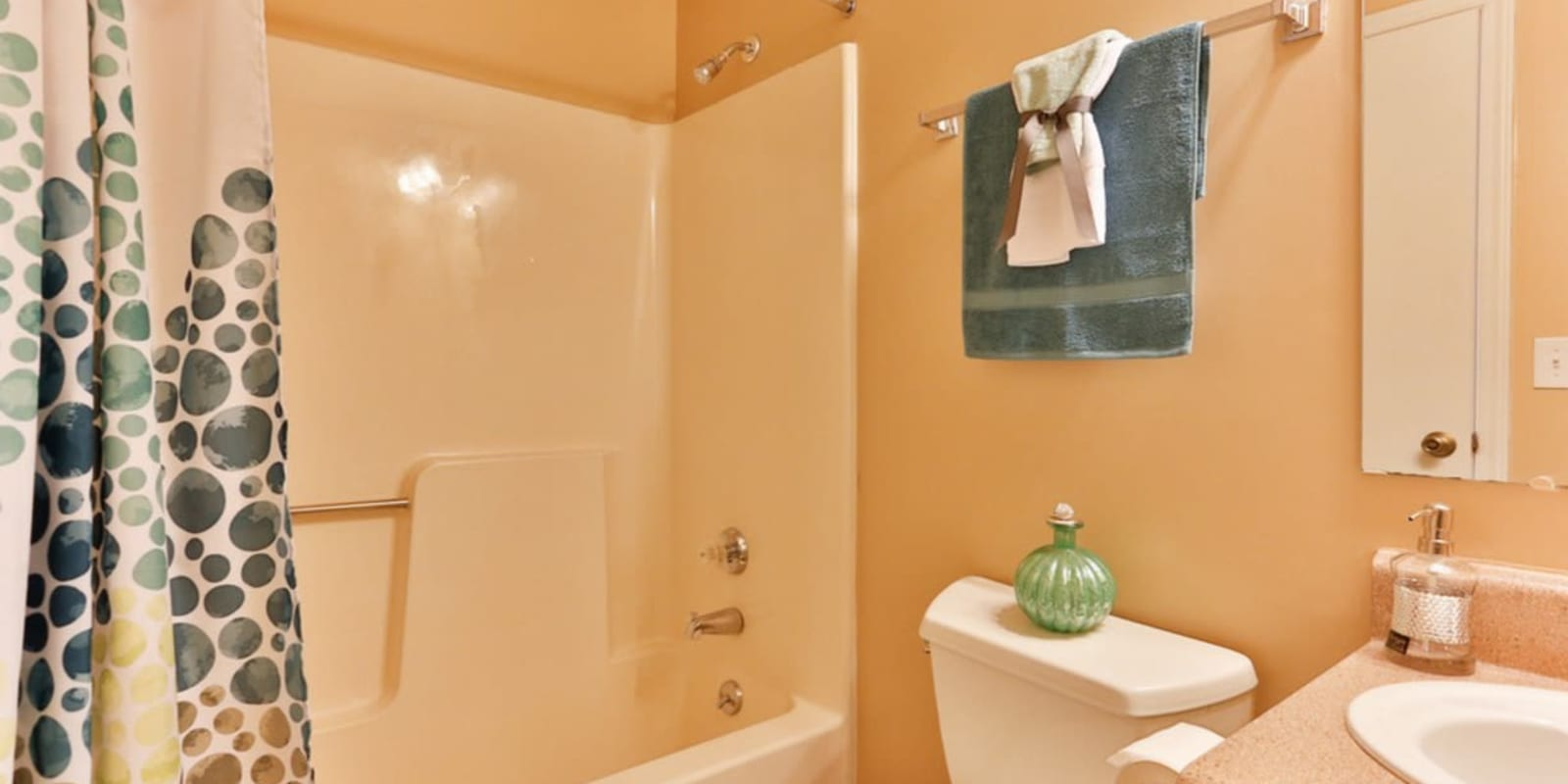 A bathroom with an oval tub at Huntersville Apartment Homes in Huntersville, North Carolina