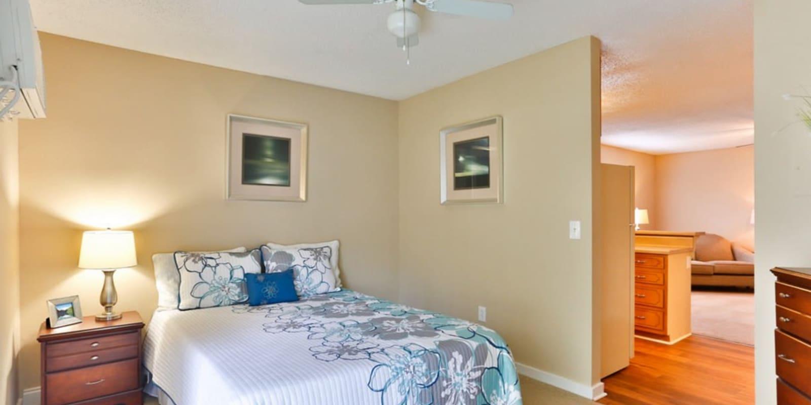 Bedroom with plush carpeting at Huntersville Apartment Homes in Huntersville, North Carolina
