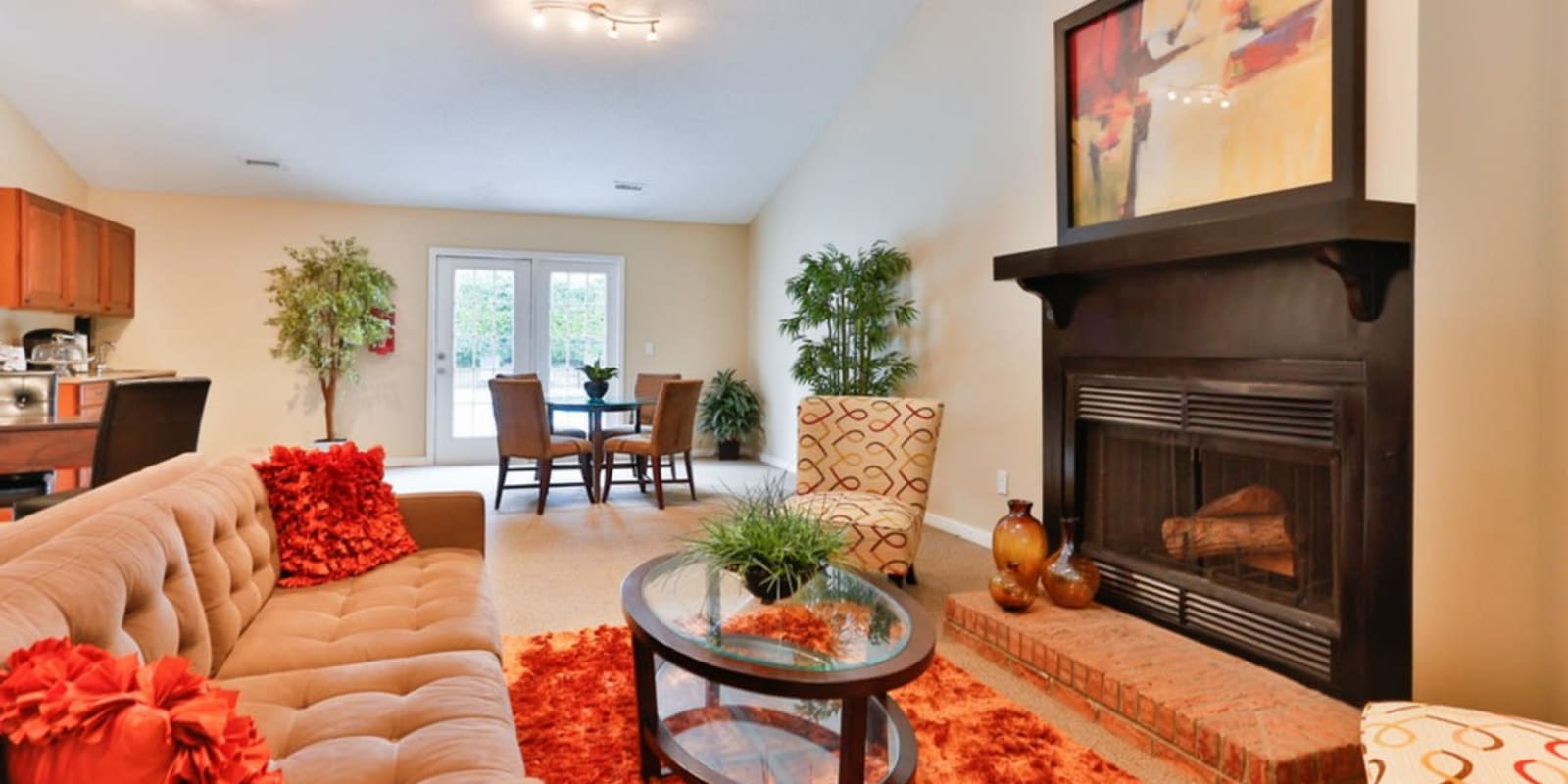 Clubhouse with a community kitchen for entertaining guests at Huntersville Apartment Homes in Huntersville, North Carolina