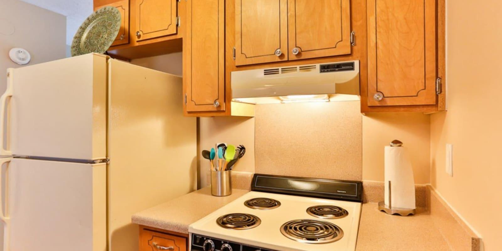 Kitchen with white appliances at Huntersville Apartment Homes in Huntersville, North Carolina