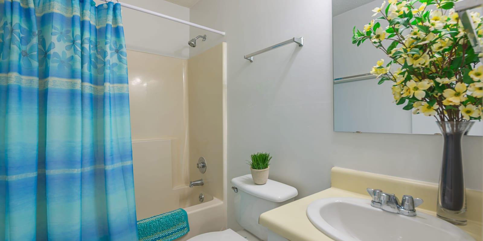 A bathroom with an oval tub at Lakewood Apartment Homes in Salisbury, North Carolina