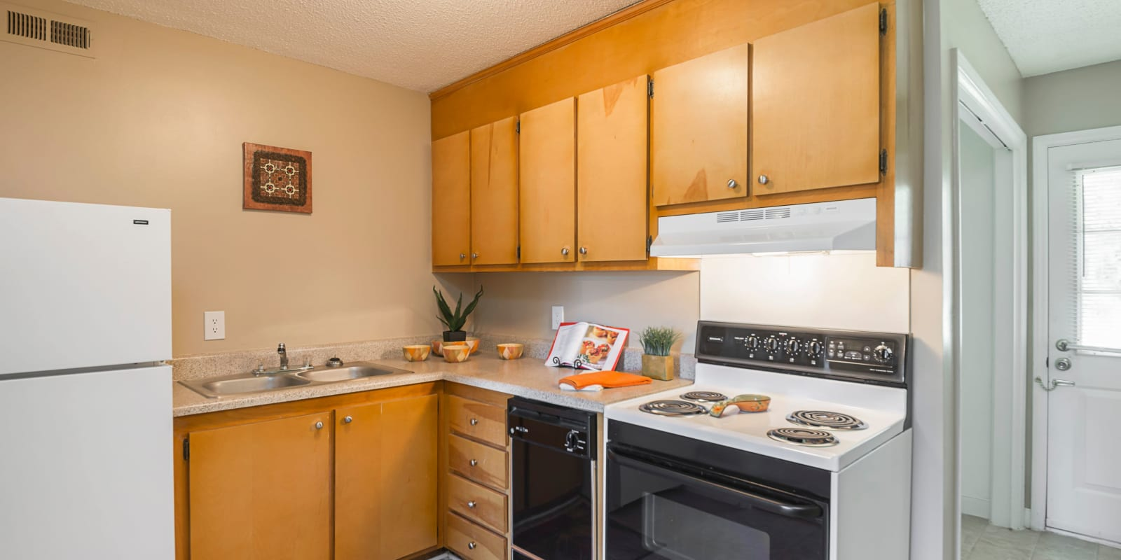 A kitchen with white appliances at Lakewood Apartment Homes in Salisbury, North Carolina