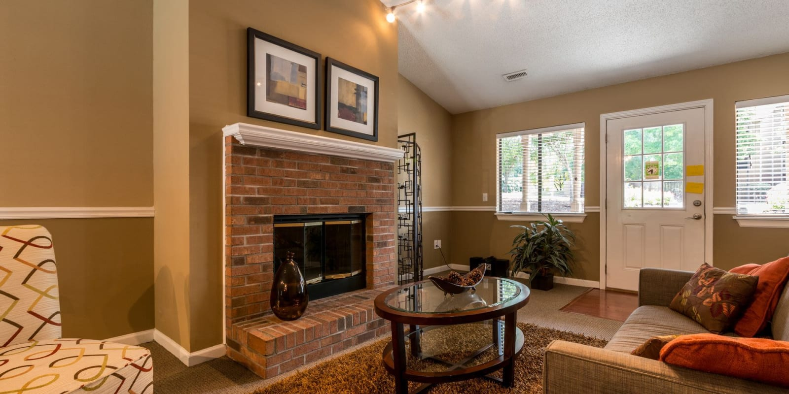 Clubhouse interior with a fireplace at Waters Edge Apartment Homes in Concord, North Carolina