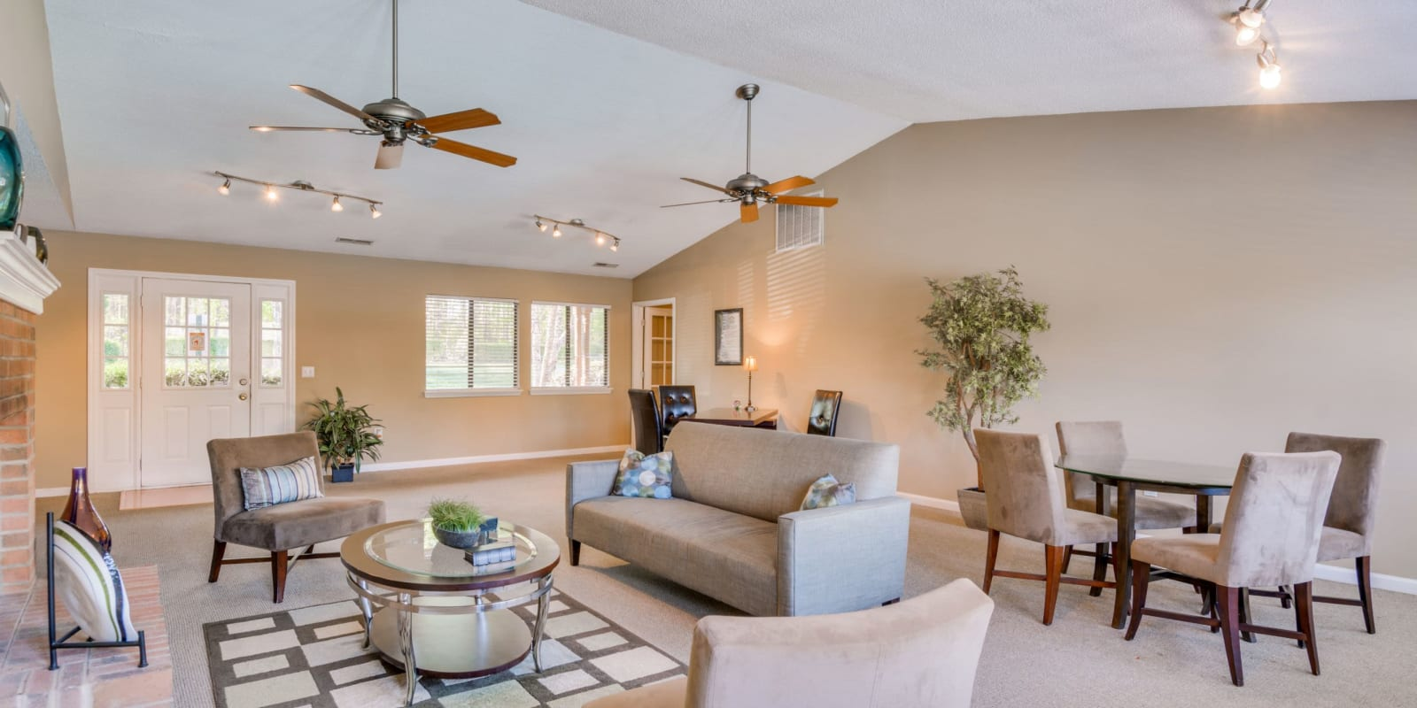 Clubhouse with ceiling fans at Woodbrook Apartment Homes in Monroe, North Carolina