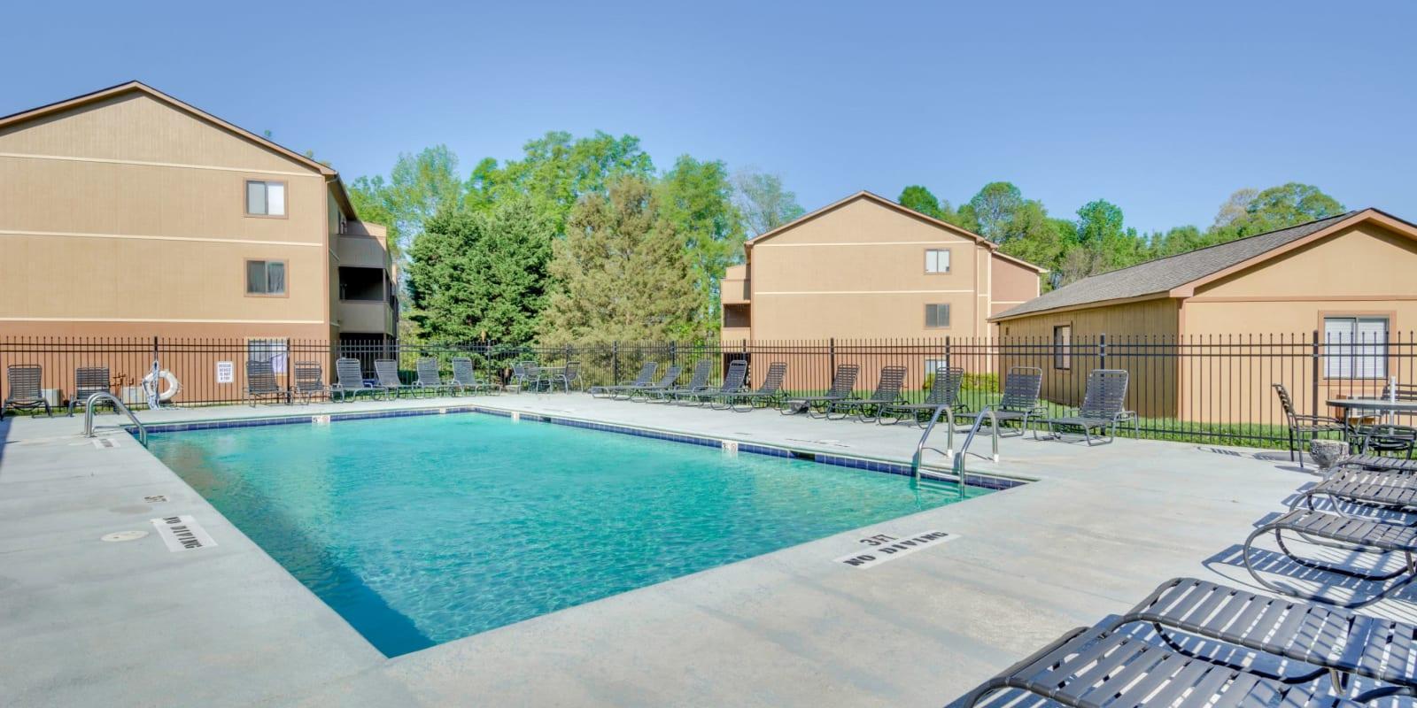 A large swimming pool for hot summer days at Woodbrook Apartment Homes in Monroe, North Carolina