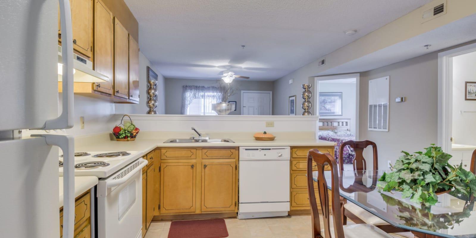 Kitchen with vinyl flooring at Woodbrook Apartment Homes in Monroe, North Carolina