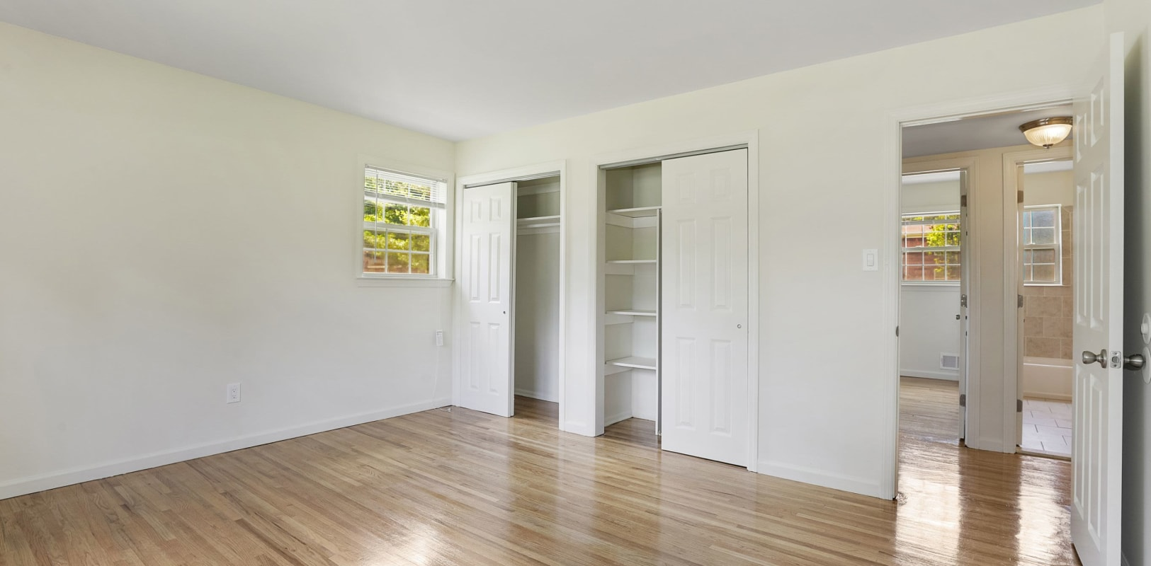 Bedroom with plenty of closet space at Madison Arms in Old Bridge, New Jersey