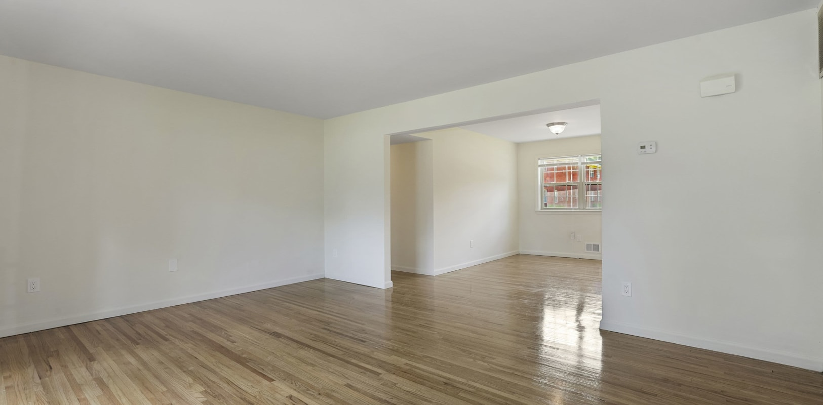 Open concept floor plans with wood style flooring at Madison Arms in Old Bridge, New Jersey