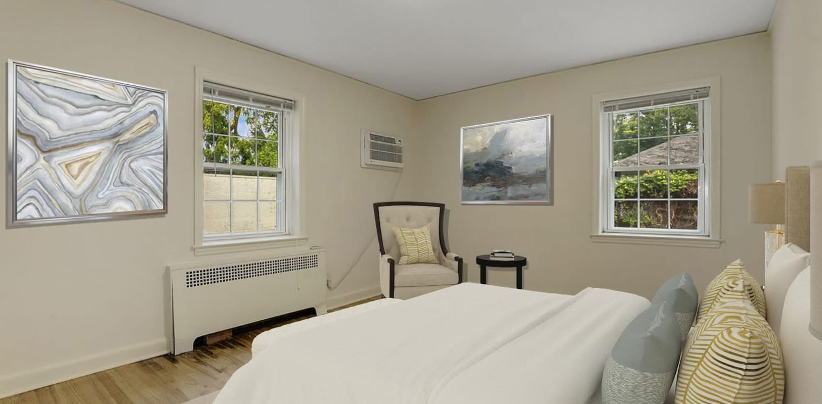 Bedroom with wood style flooring at Mayflower Apartments in Ridgewood, New Jersey