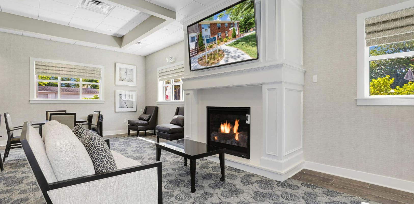 Lounge with a fireplace at Nieuw Amsterdam Village in South Amboy, New Jersey
