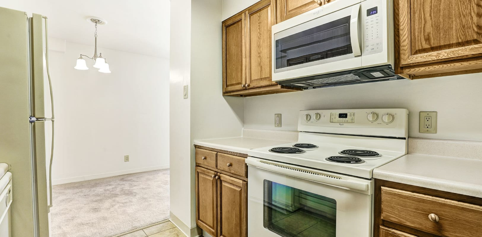 Bright kitchen with white appliances at Bethlehem Towers in Bethlehem, Pennsylvania