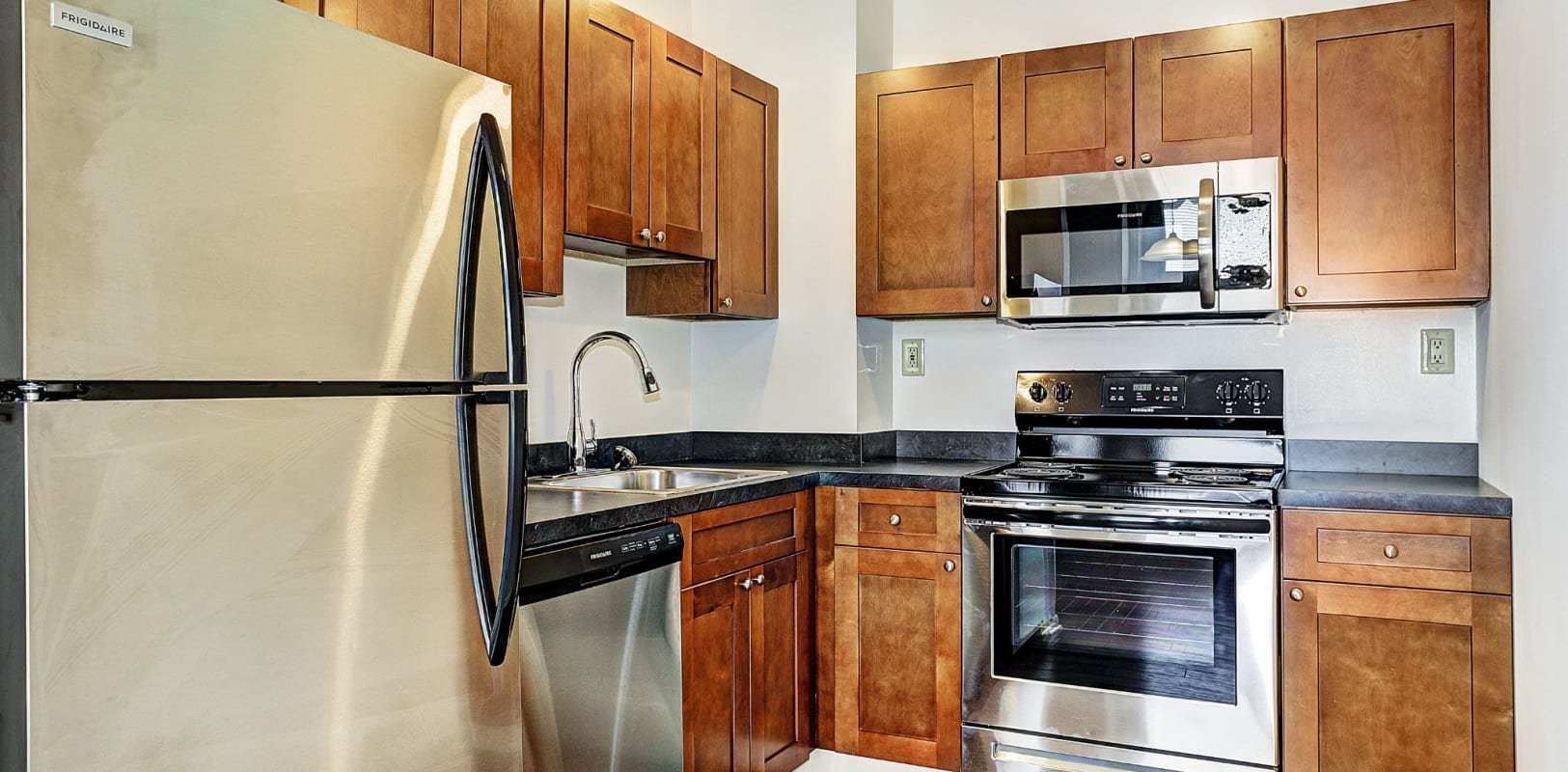 Kitchen with stainless steel appliances at Brighton Court in Bethlehem, Pennsylvania