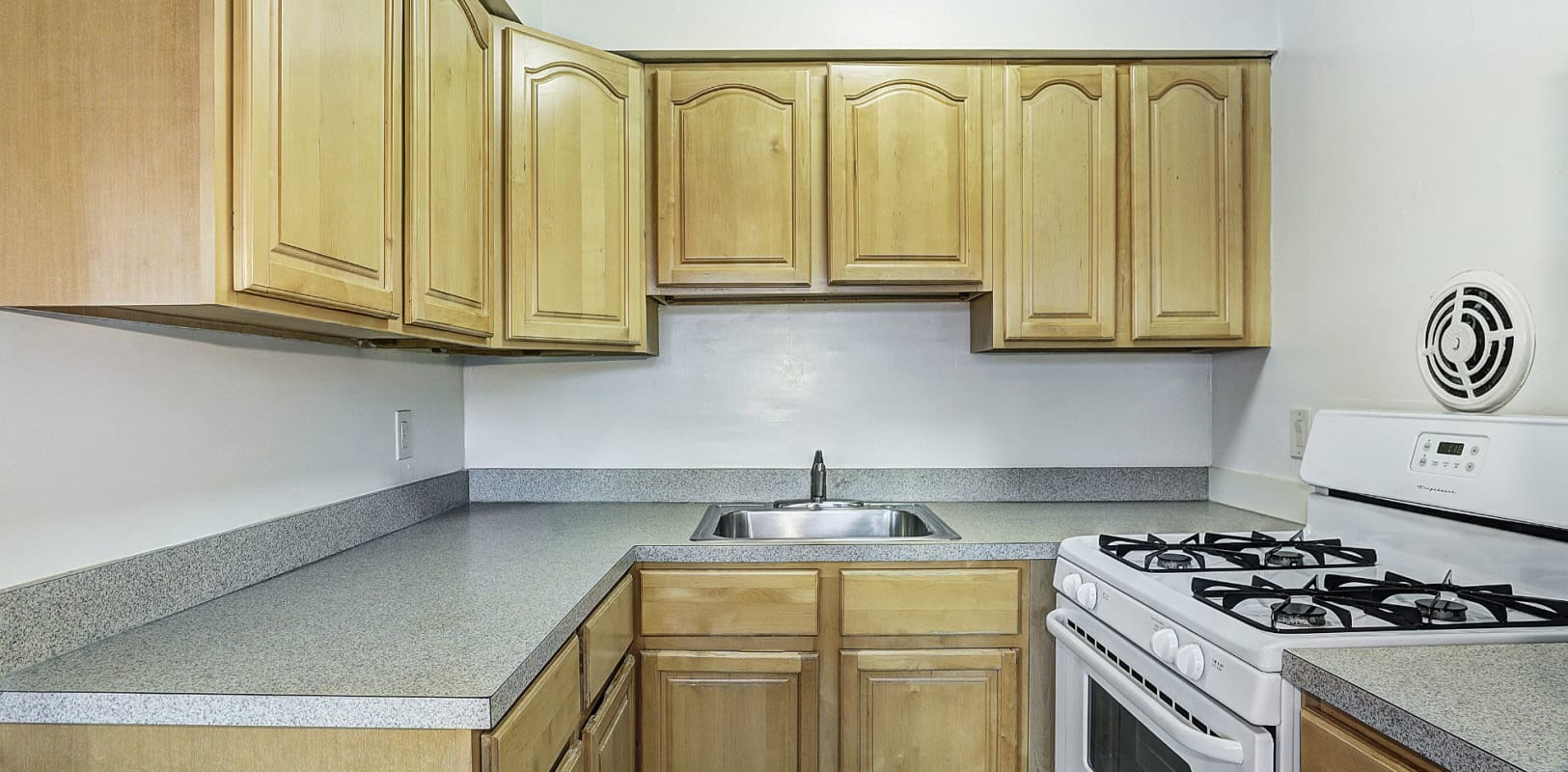 Kitchen with plenty of counter space at Garret Village Apartments in Clifton, New Jersey