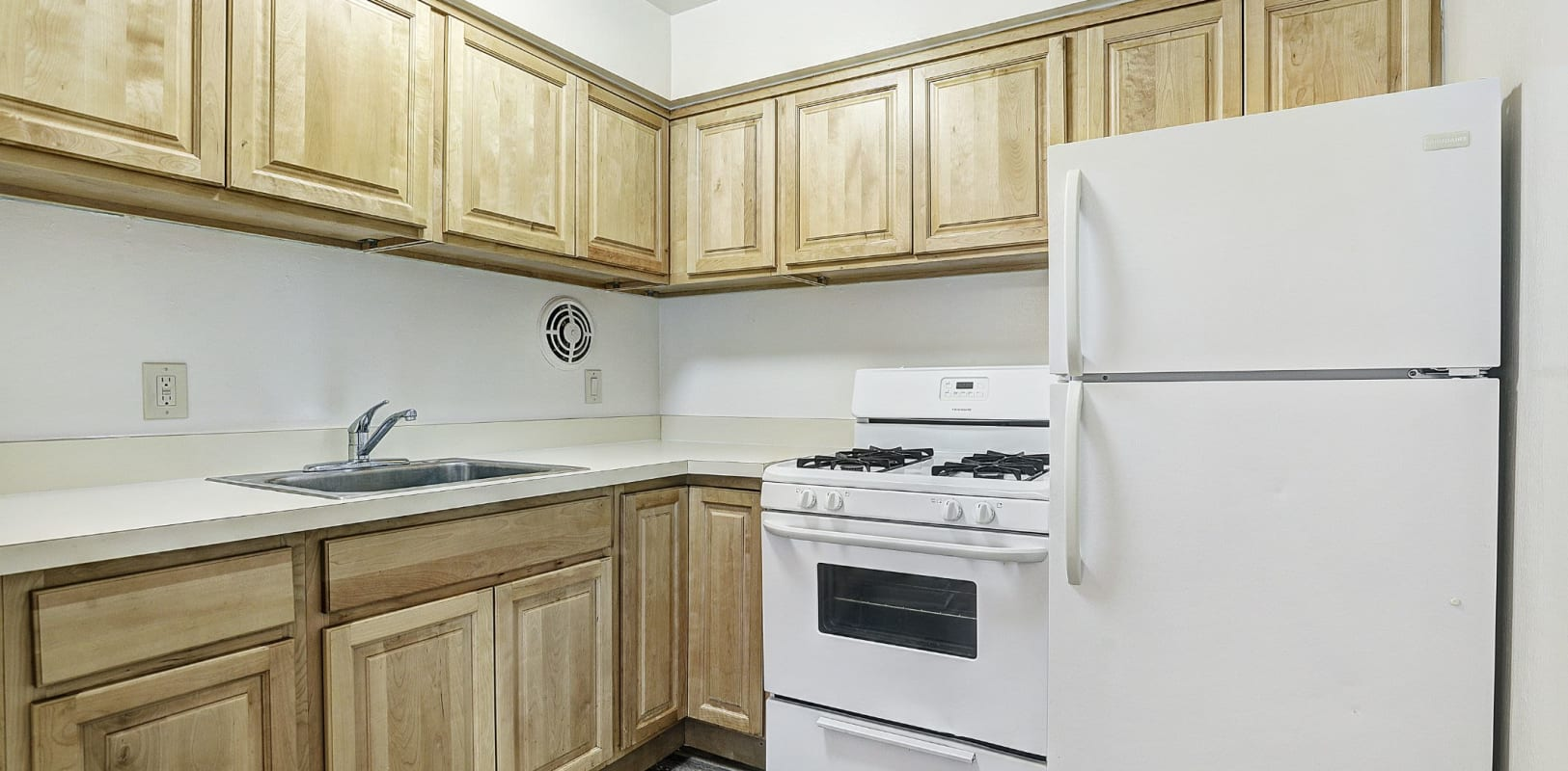 Fully equipped kitchen at Garret Village Apartments in Clifton, New Jersey