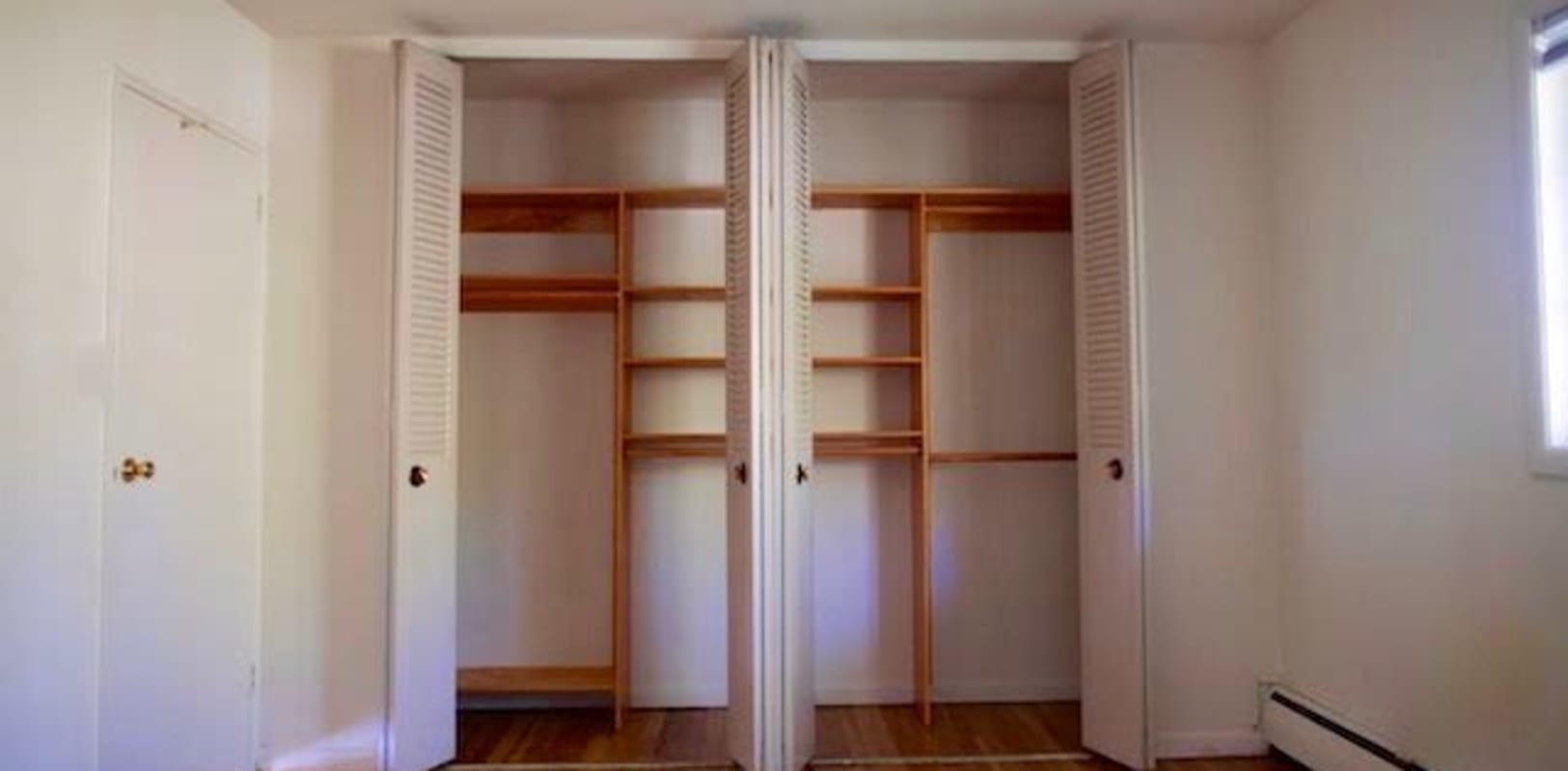 Bedroom with plenty of closet space at Eastgate Apartments in Ewing, New Jersey