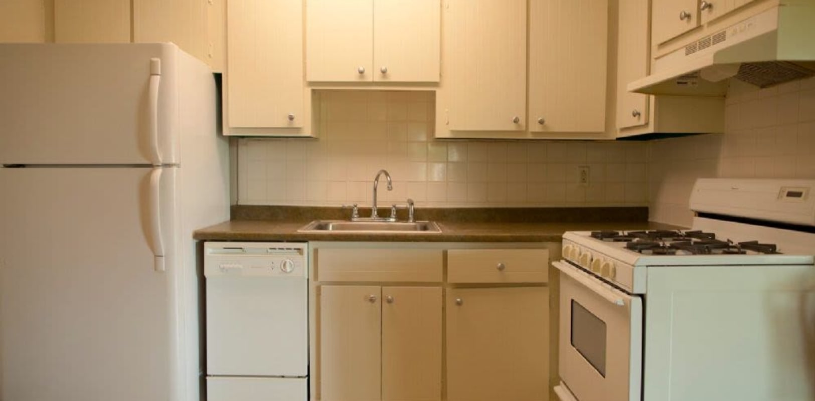 Kitchen with white appliances at Glen Wall Heights in Wall Township, New Jersey
