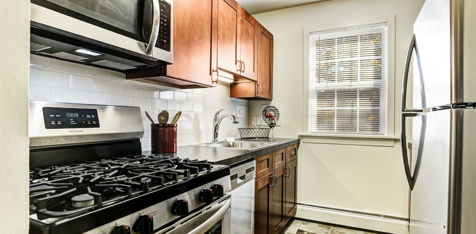 Kitchen with stainless steel appliances at Lehigh Plaza Apartments in Bethlehem, Pennsylvania