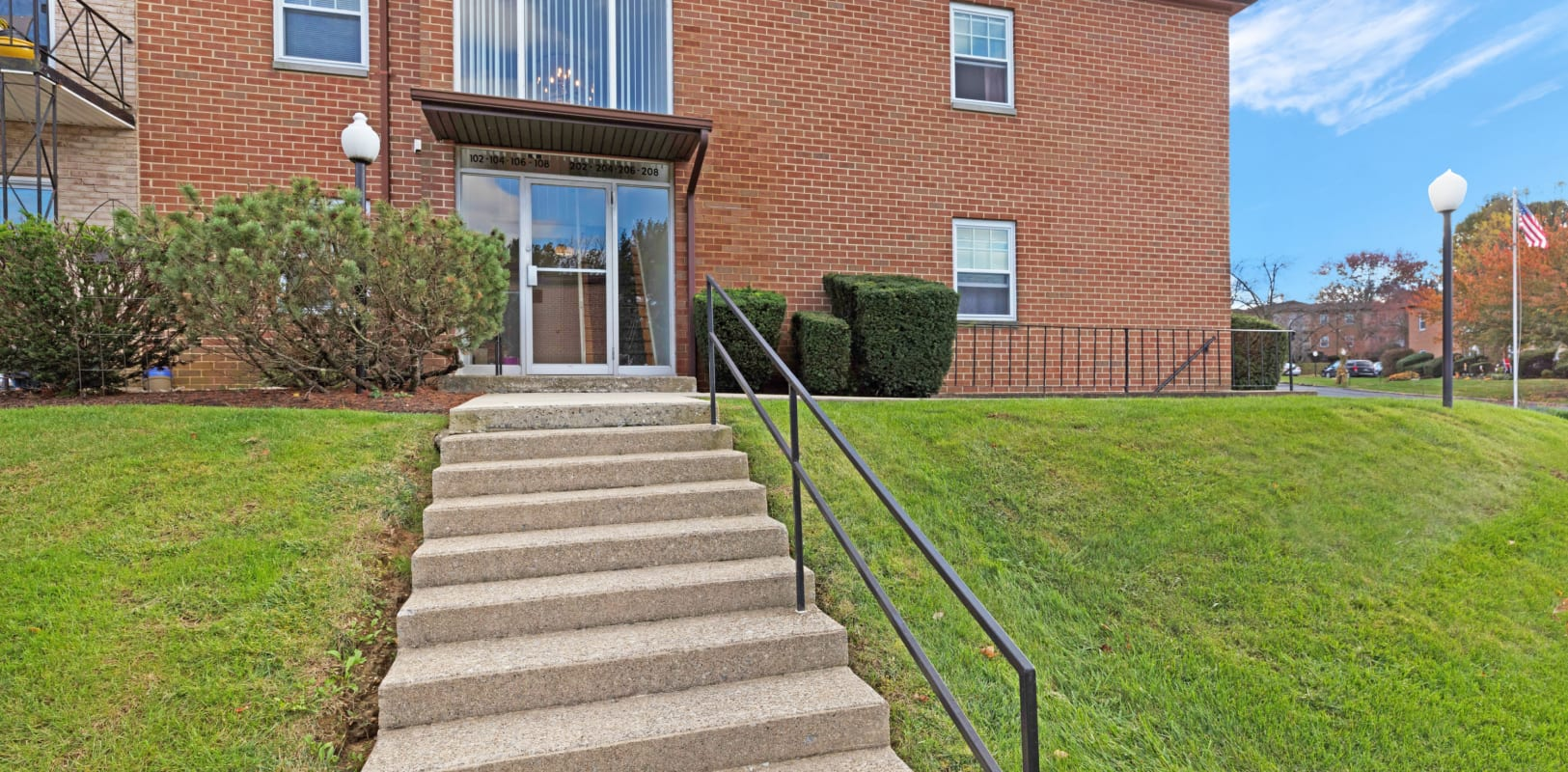 Stairway with handrail up to the beautiful brick Northfield Apartments in Bethlehem, Pennsylvania