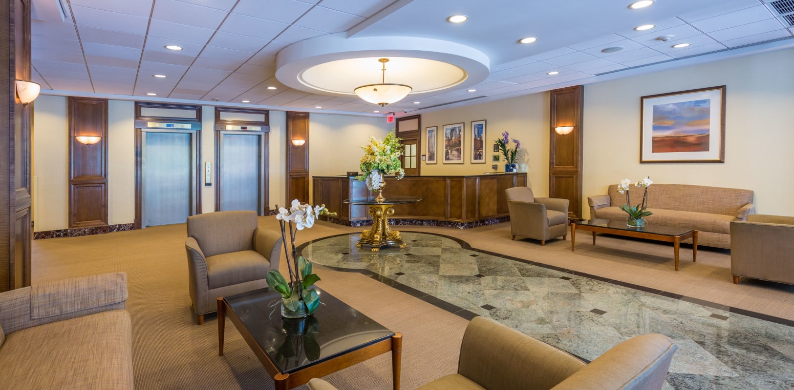 Tiled lobby walkway with modern furniture surrounded for residents to relax on at Nottingham Manor in Montvale, New Jersey