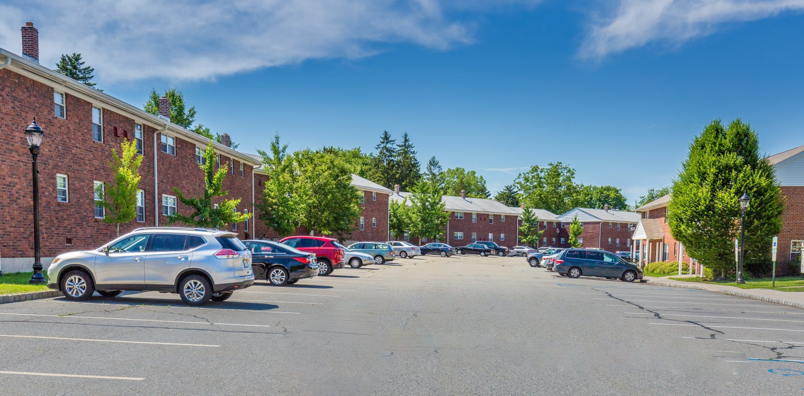 Large parking lot with plenty of space for residents to park at Nottingham Manor in Montvale, New Jersey