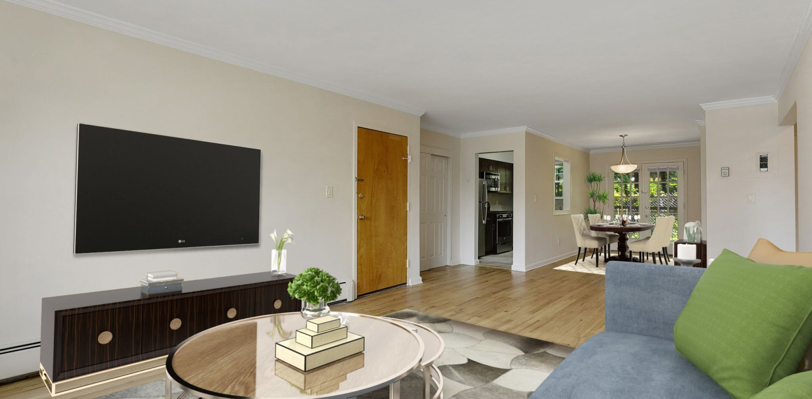 Livingroom with large wall mounted tv at Parkway East Apartments in Caldwell, New Jersey