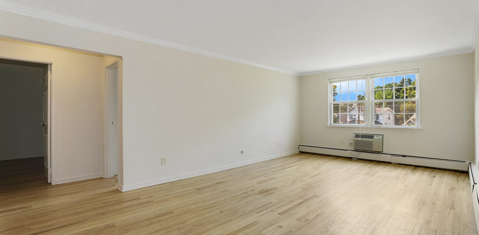 Large empty living room ready for move in at Parkway East Apartments in Caldwell, New Jersey