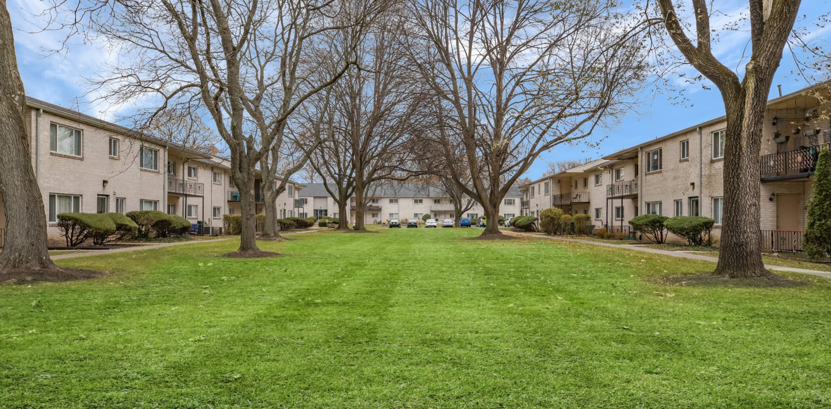 Massive lawn to enjoy with trees to provide ample shade in the summer at Penn Crest Apartments in Allentown, Pennsylvania