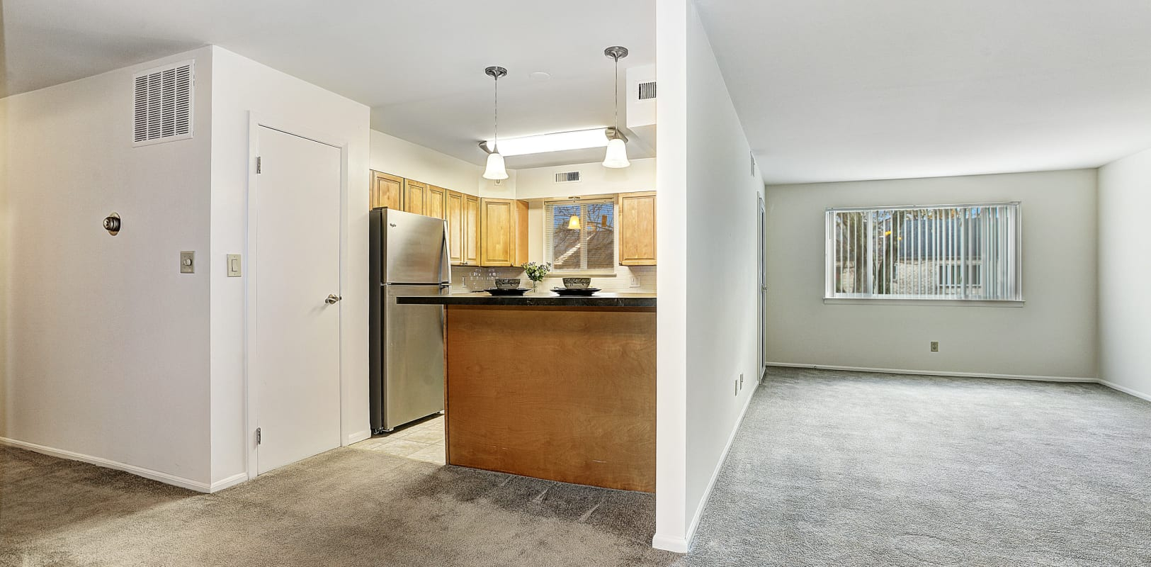Kitchen and living room ready for move in at Penn Crest Apartments in Allentown, Pennsylvania
