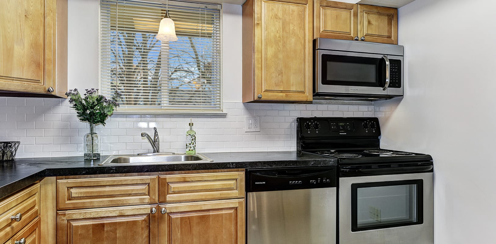 Kitchen with nice light wood style cabinets at Penn Crest Apartments in Allentown, Pennsylvania