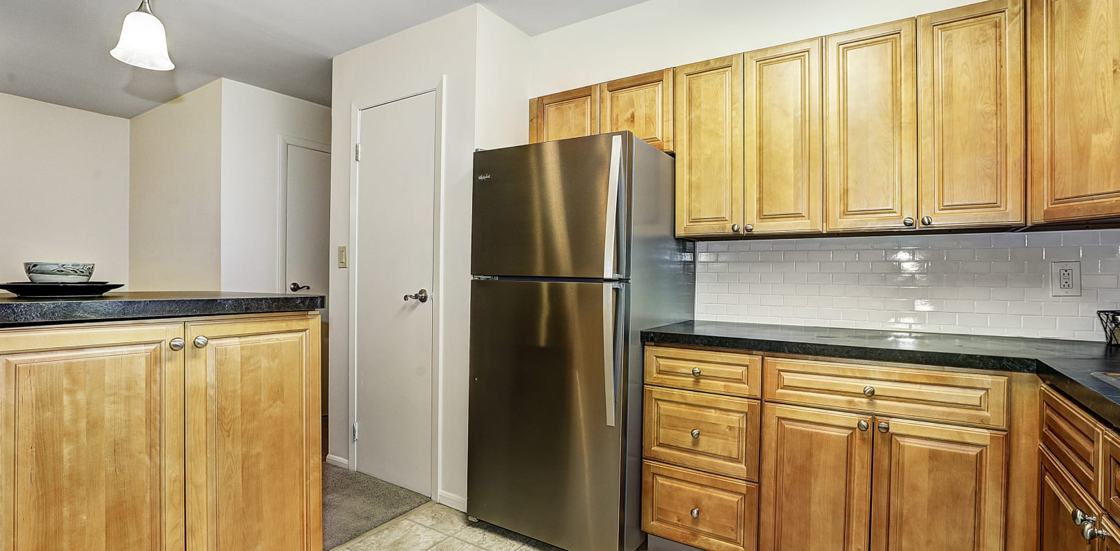 Stainless steel fridge and ample counter space in the kitchen at Penn Crest Apartments in Allentown, Pennsylvania