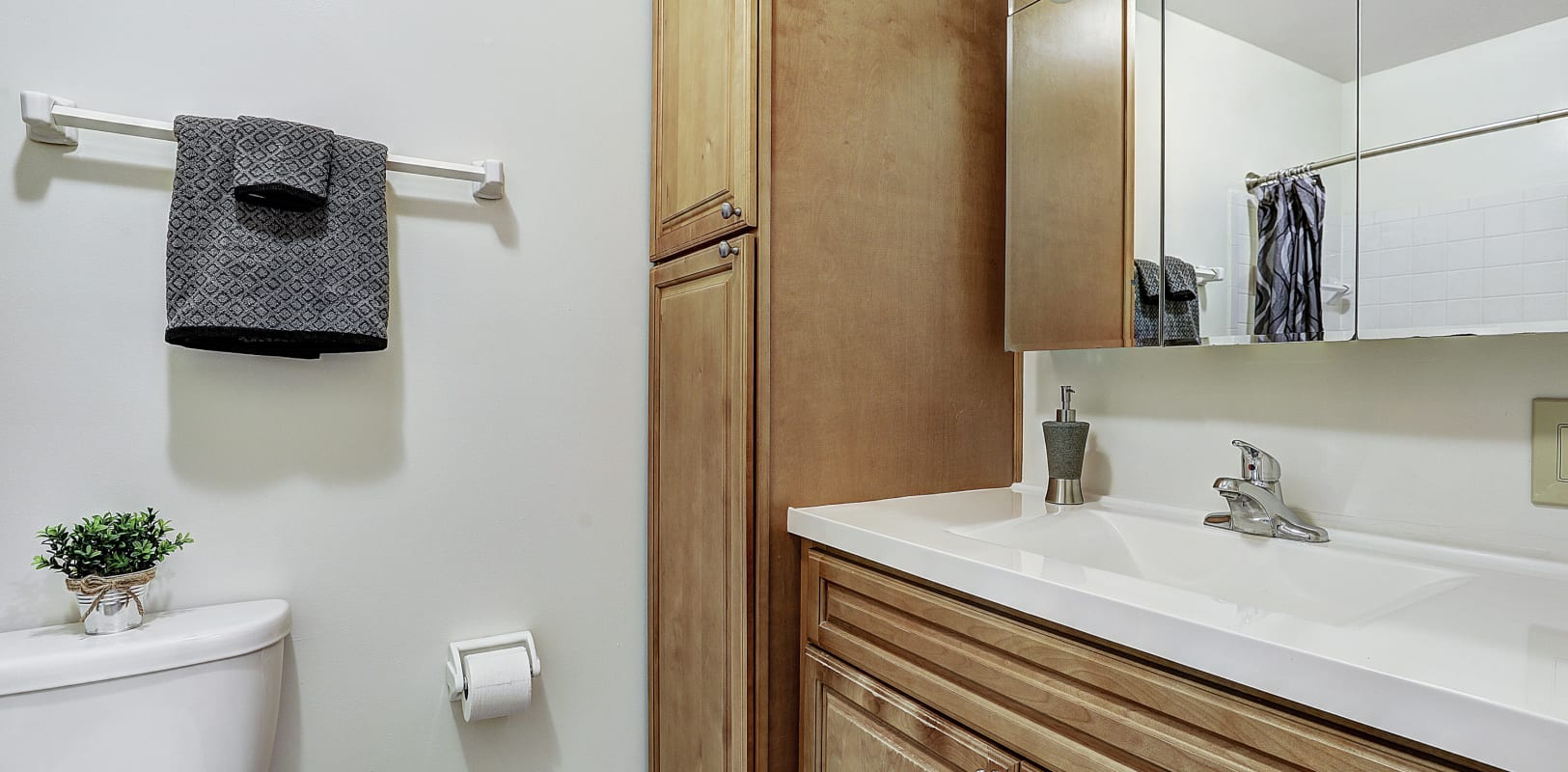 Bathroom with cabinets for storage at Penn Crest Apartments in Allentown, Pennsylvania