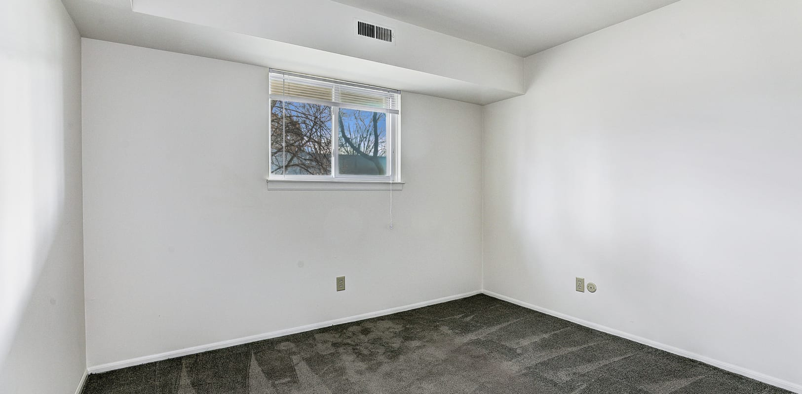 Carpeted bedroom with white walls at Penn Crest Apartments in Allentown, Pennsylvania