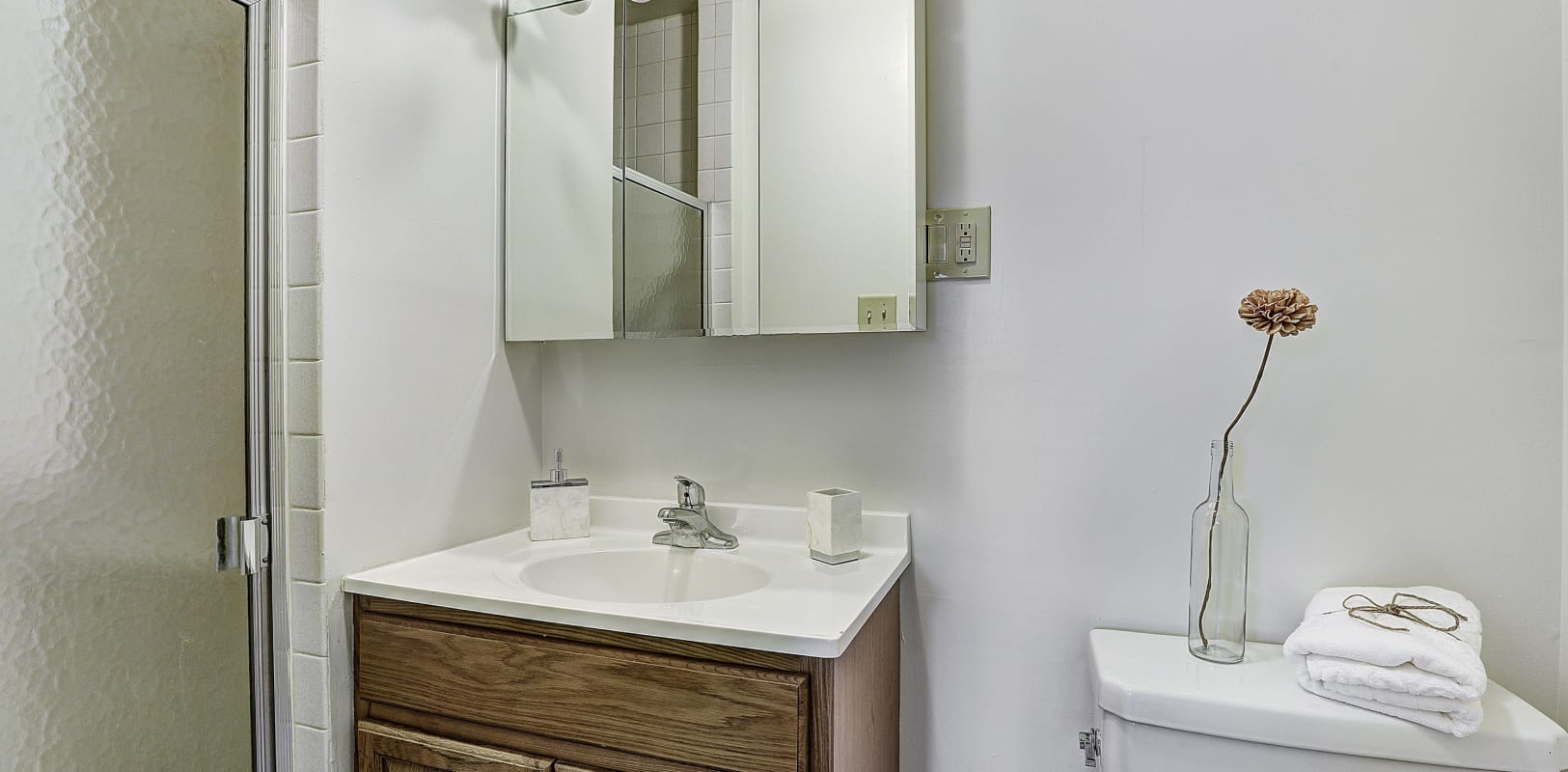 Nice bathroom with wood style vanity at Penn Crest Apartments in Allentown, Pennsylvania