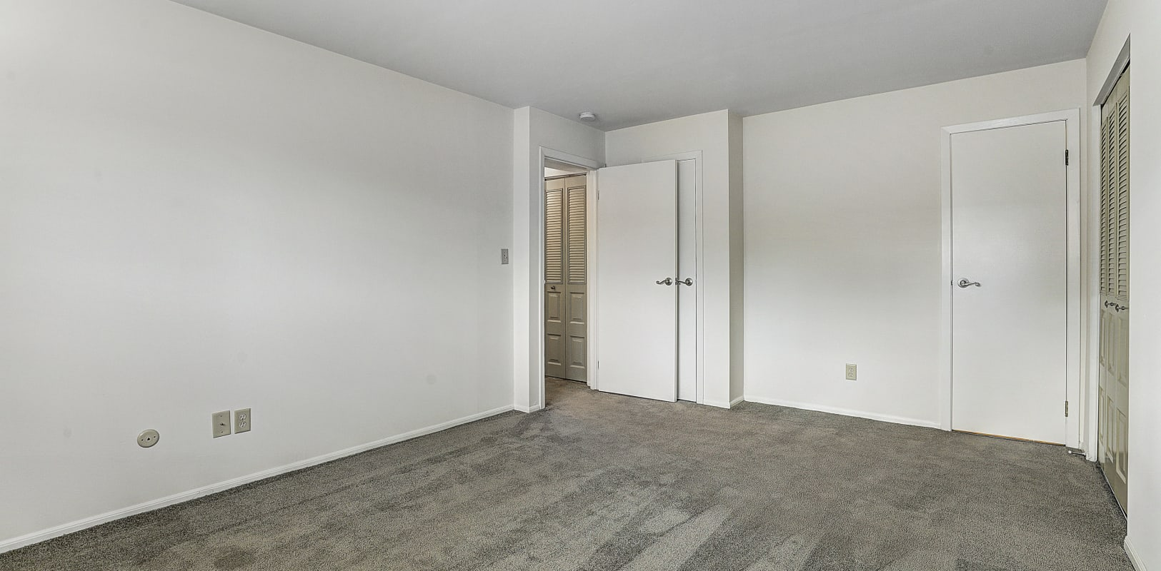 Large empty bedroom ready for move in at Penn Crest Apartments in Allentown, Pennsylvania