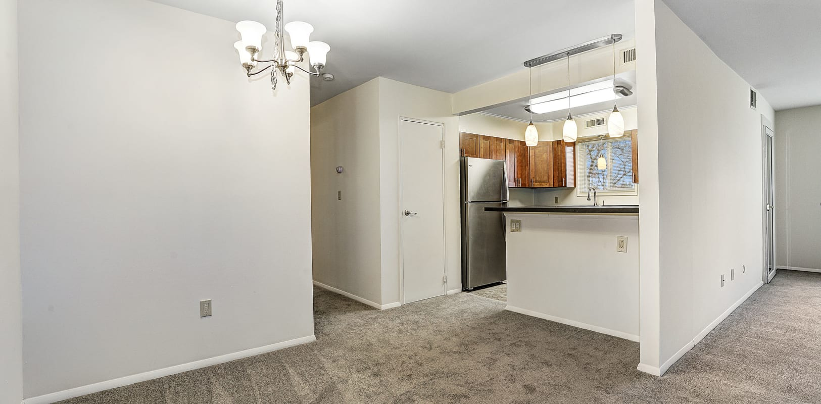 Dining area and kitchen breakfast bar at Penn Crest Apartments in Allentown, Pennsylvania