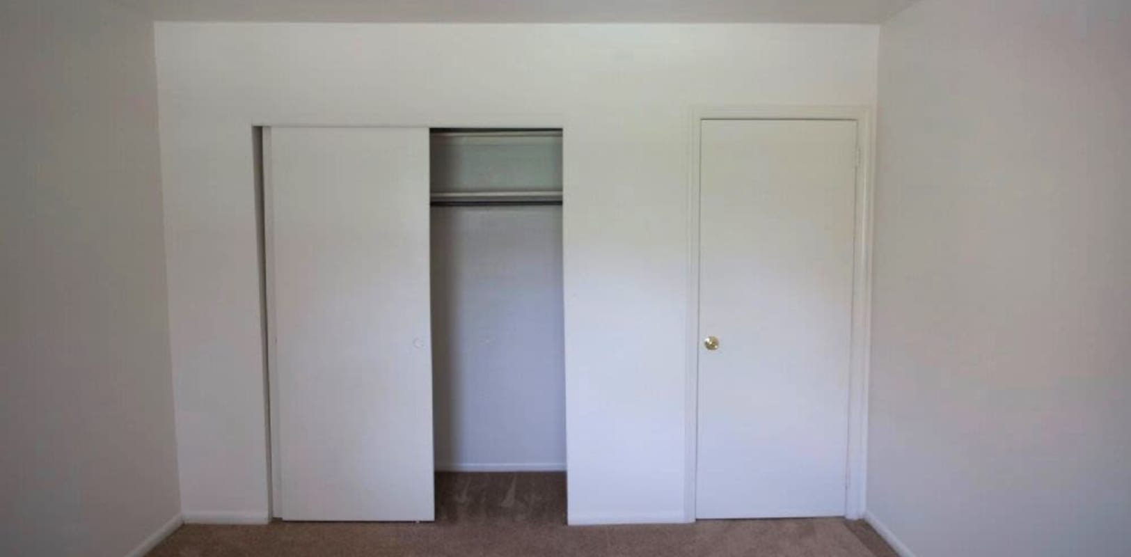 Bedroom with closet space for extra storage at Spring Valley Apartments in Sinking Spring, Pennsylvania