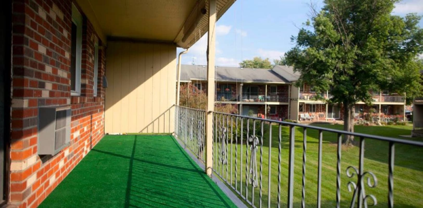 Balcony with nice green turf at Spring Valley Apartments in Sinking Spring, Pennsylvania
