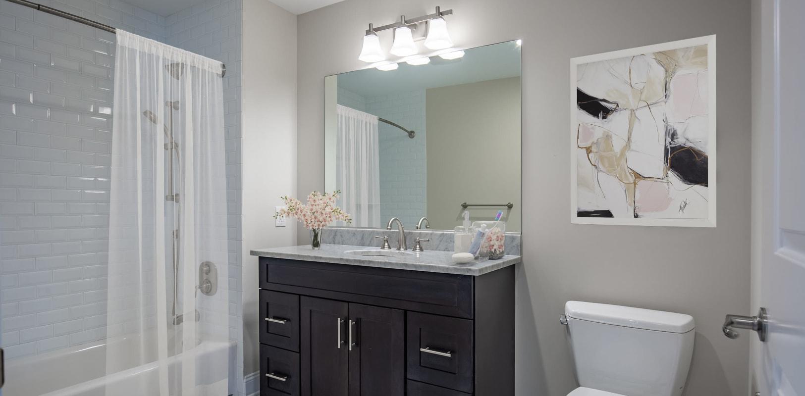 Modern bathroom with black vanity at Zephyr Ridge in Cedar Grove, New Jersey