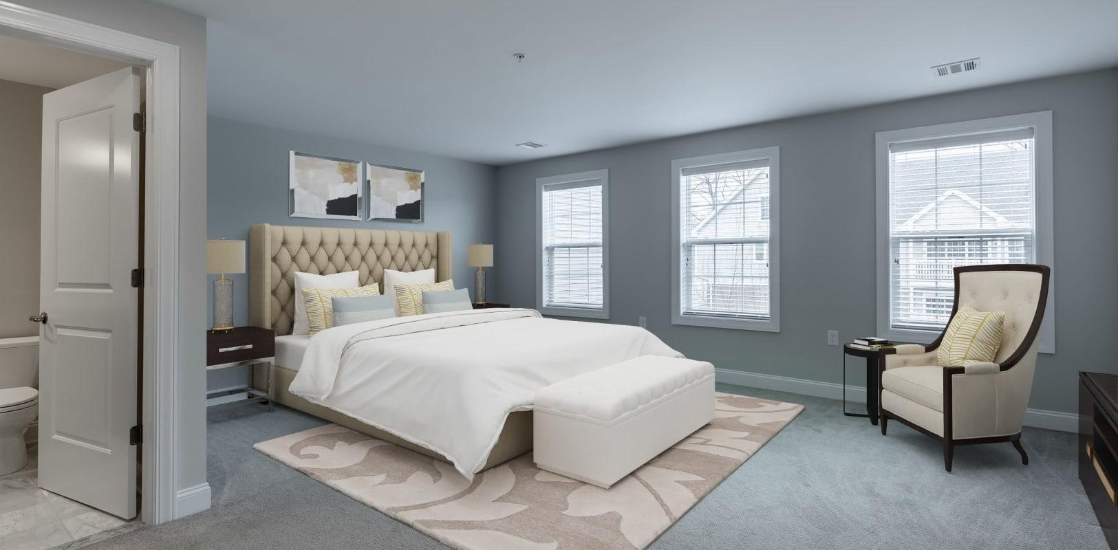 Model bedroom with lots of windows for light at Zephyr Ridge in Cedar Grove, New Jersey