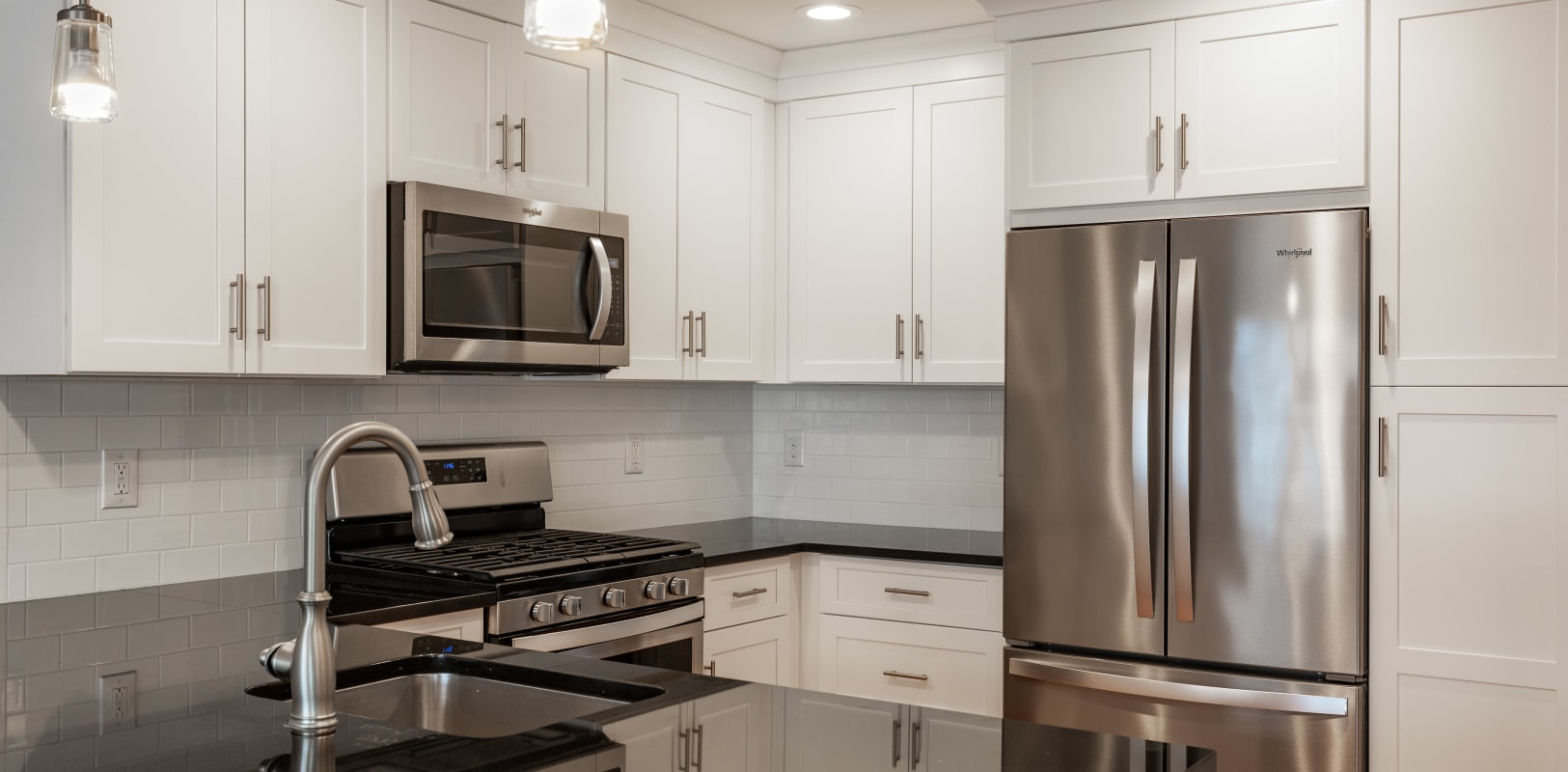 Modern looking kitchen with stainless steel appliances at Zephyr Ridge in Cedar Grove, New Jersey