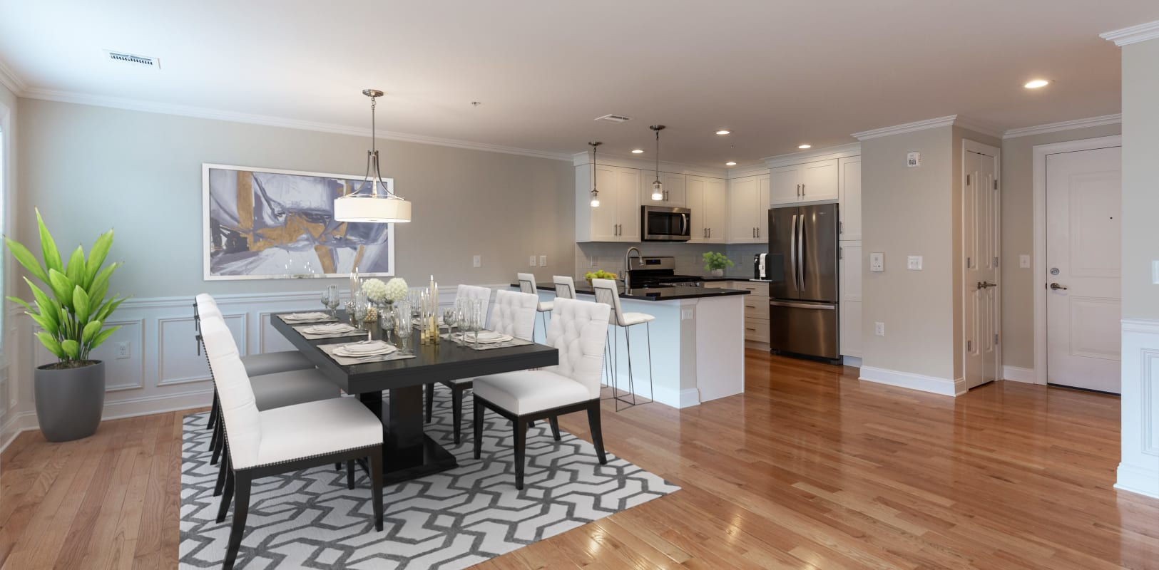 Kitchen and dining room with hardwood floors at Zephyr Ridge in Cedar Grove, New Jersey