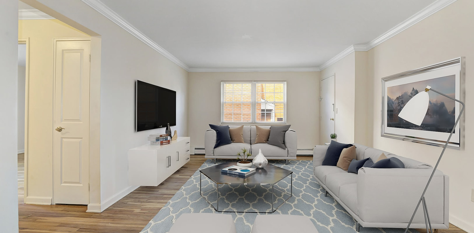 Spacious living room with hardwood flooring at Park Lane Apartments in Little Falls, New Jersey