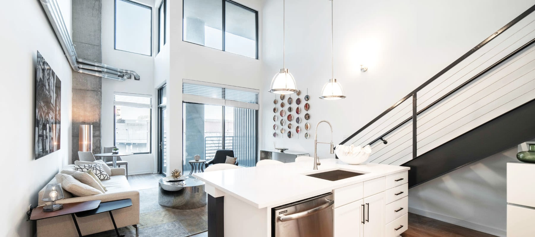 Bright and open layout in a model loft home at 17th Street Lofts in Atlanta, Georgia